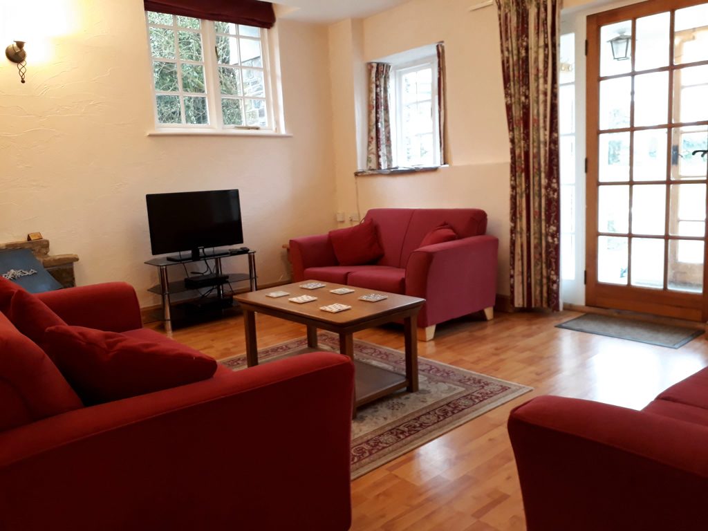 The Shippon Sitting Room at Lower Hearson Farm Holiday Cottage North Devon